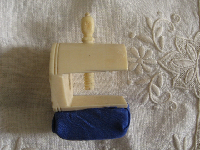 Antique ivory sewing clamp