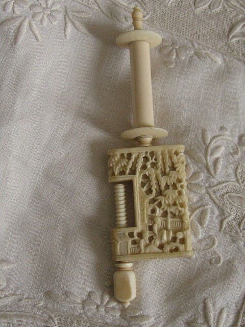 Antique carved Chinese sewing clamp