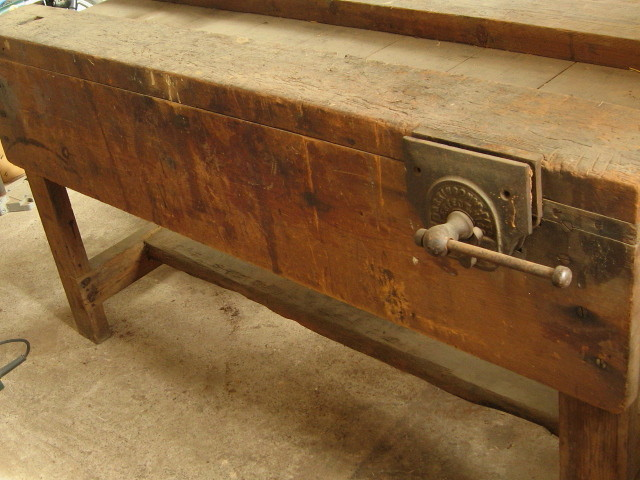 Antique industrial workbench with patina